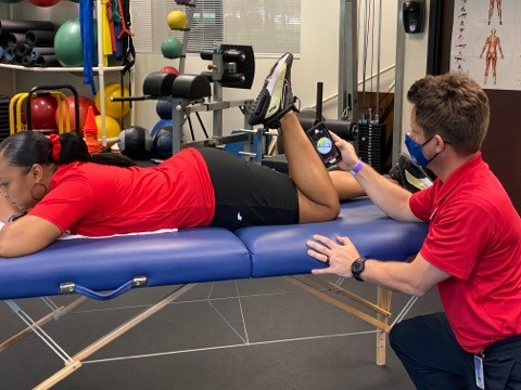 author measuring active knee flexion with smartphone