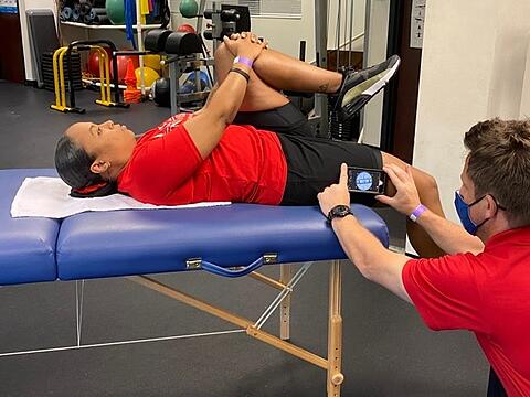 author measuring passive hip extension with smart phone