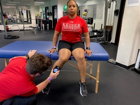 seated active hip rotation with smartphone