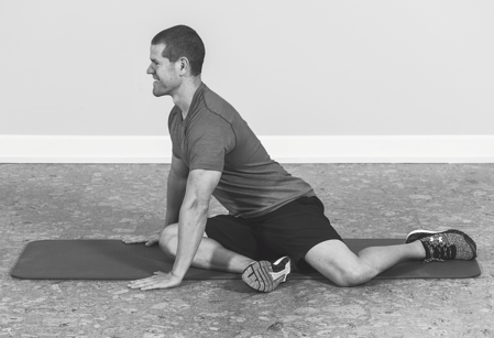 man putting weight on knee to stretch it band