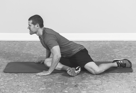 man lengthening spine to stretch it band