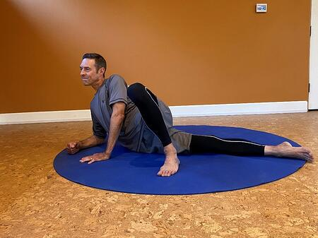man laying on side to stretch IT band