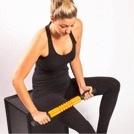 woman self-massaging soft tissue in leg