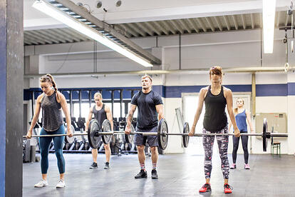 Adults Strength Training in Gym