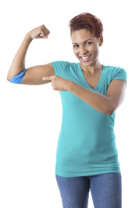 Woman pointing at bandage on arm