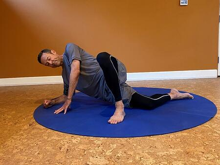 stretching progression by bending knee of first stretching step