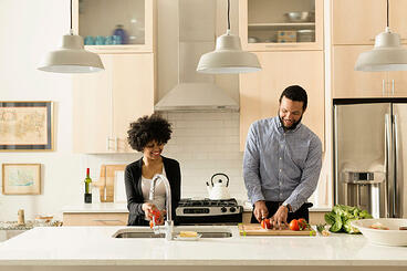 Woman and man cooking in kitchen