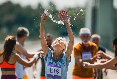 Woman pouring water on head during race