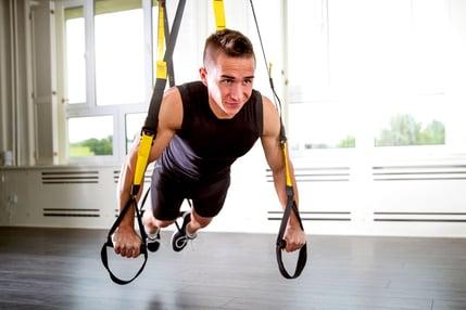 Man doing TRX exercise