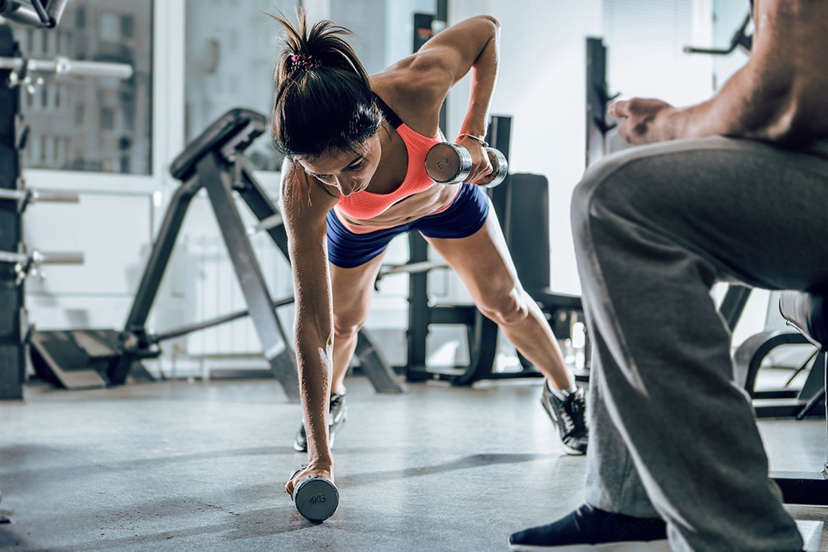 a woman doing a bent-over-row variation
