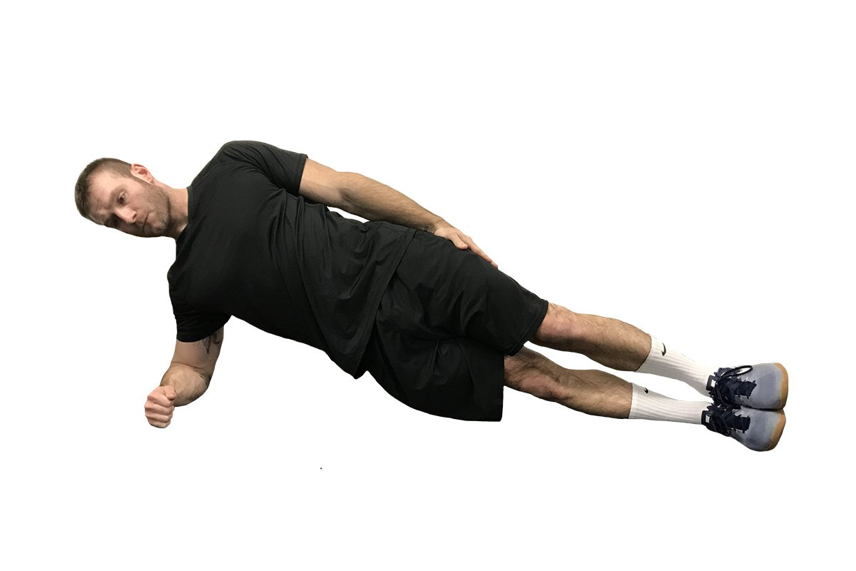 personal trainer doing a side plank