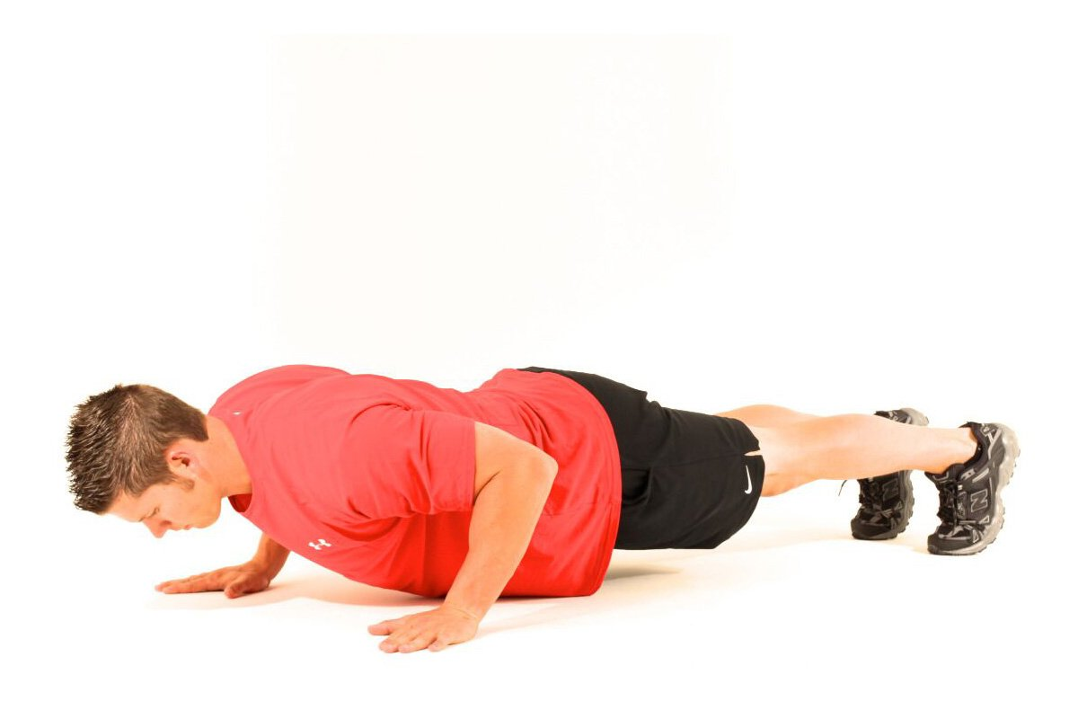 trainer doing a pushup
