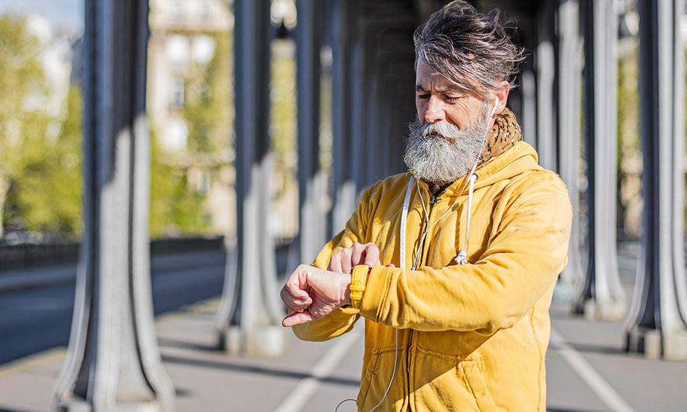 man using a health tracker before a run