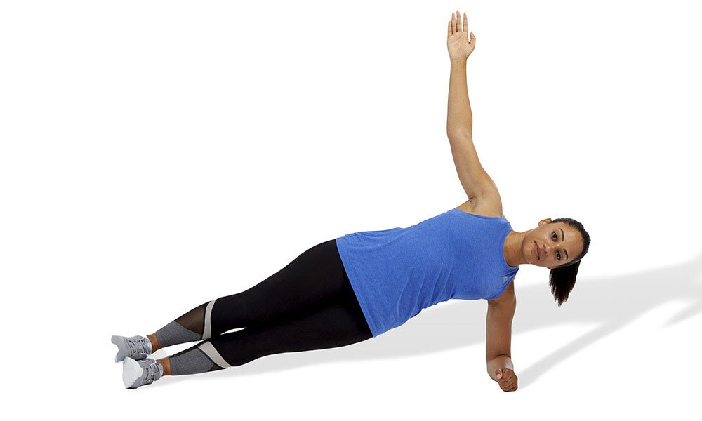 woman doing a hip-extension plank