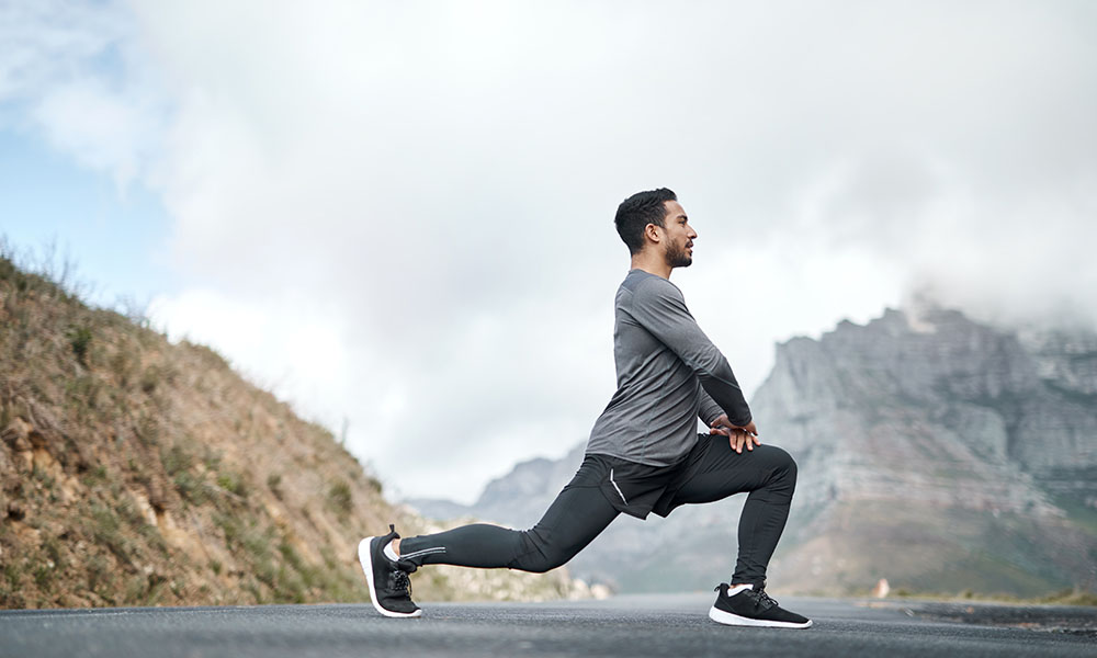 a man doing a lunge outdoors