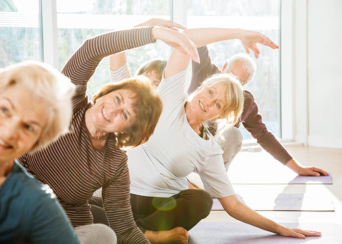 older-group-doing-yoga