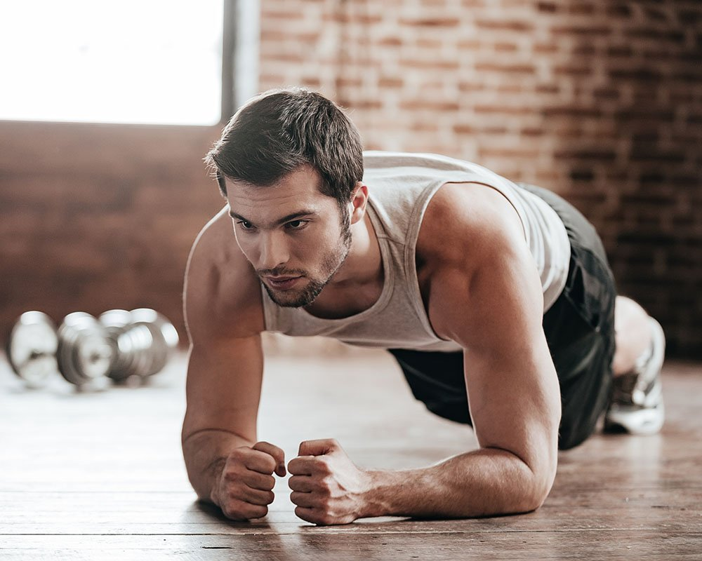 a man doing an isometric plank