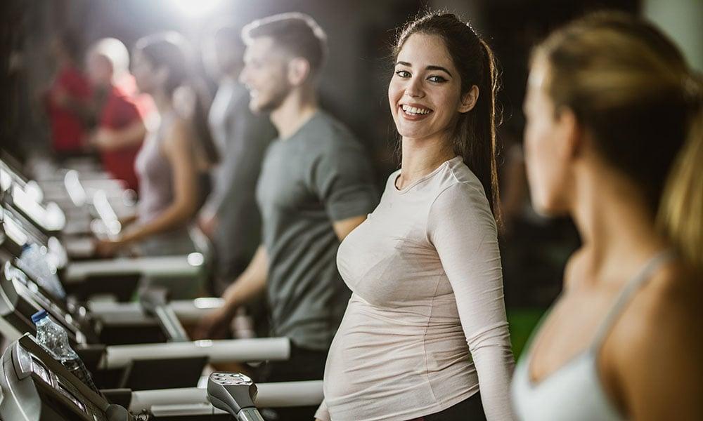 pregnant woman doing cardio on treadmill