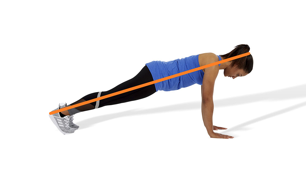 woman doing a proper form pushup
