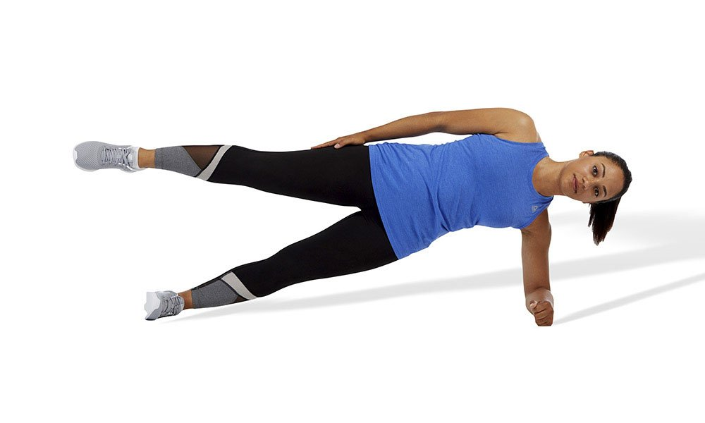 woman doing a side plank with hip abduction