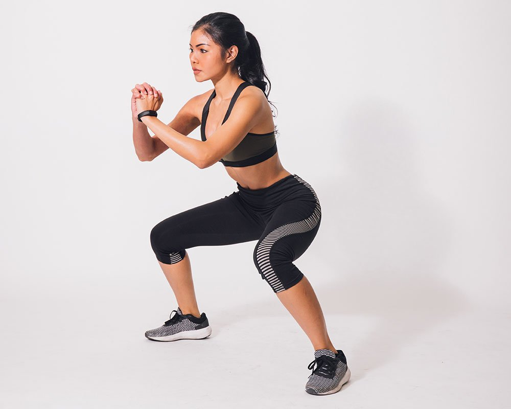 woman doing a squat hold