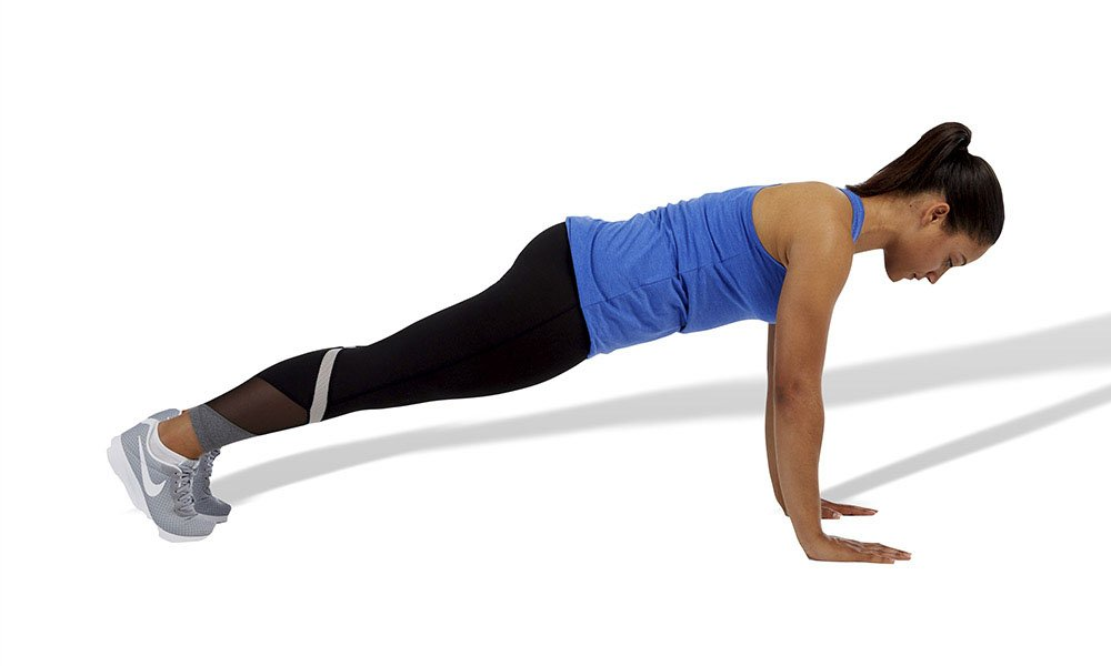 a woman performing a standard plank