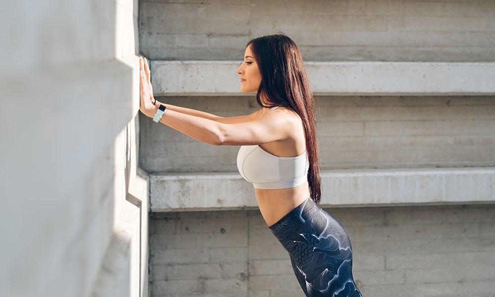 woman doing a wall pushup
