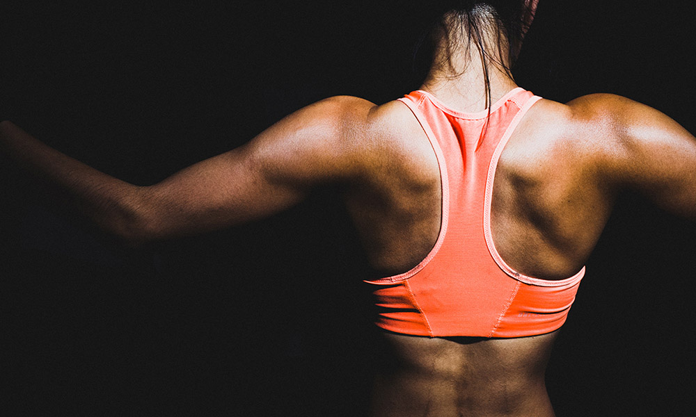 woman flexing back muscles