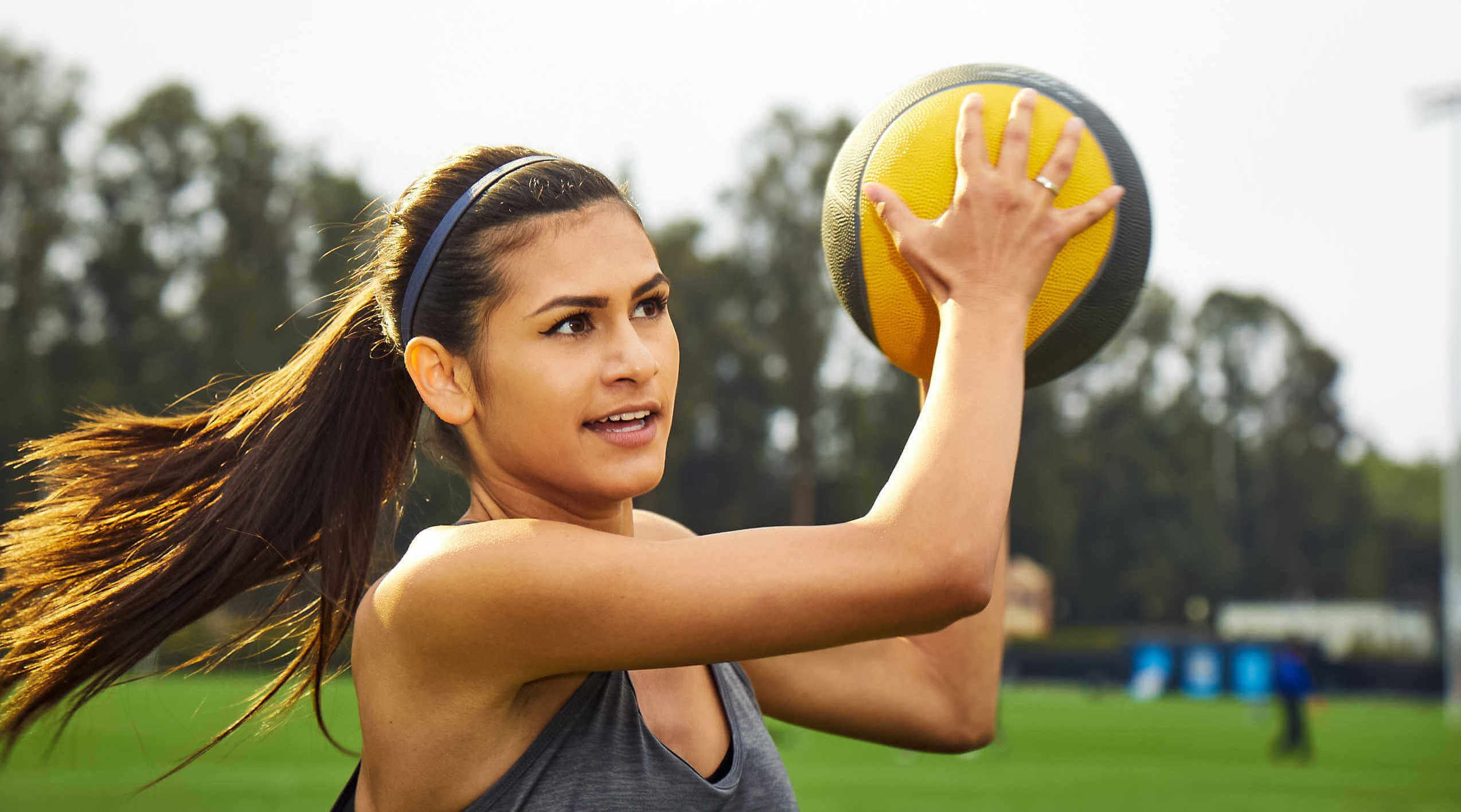 Woman holding up a medicine ball