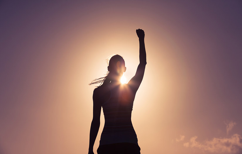 Woman putting her fist in the air