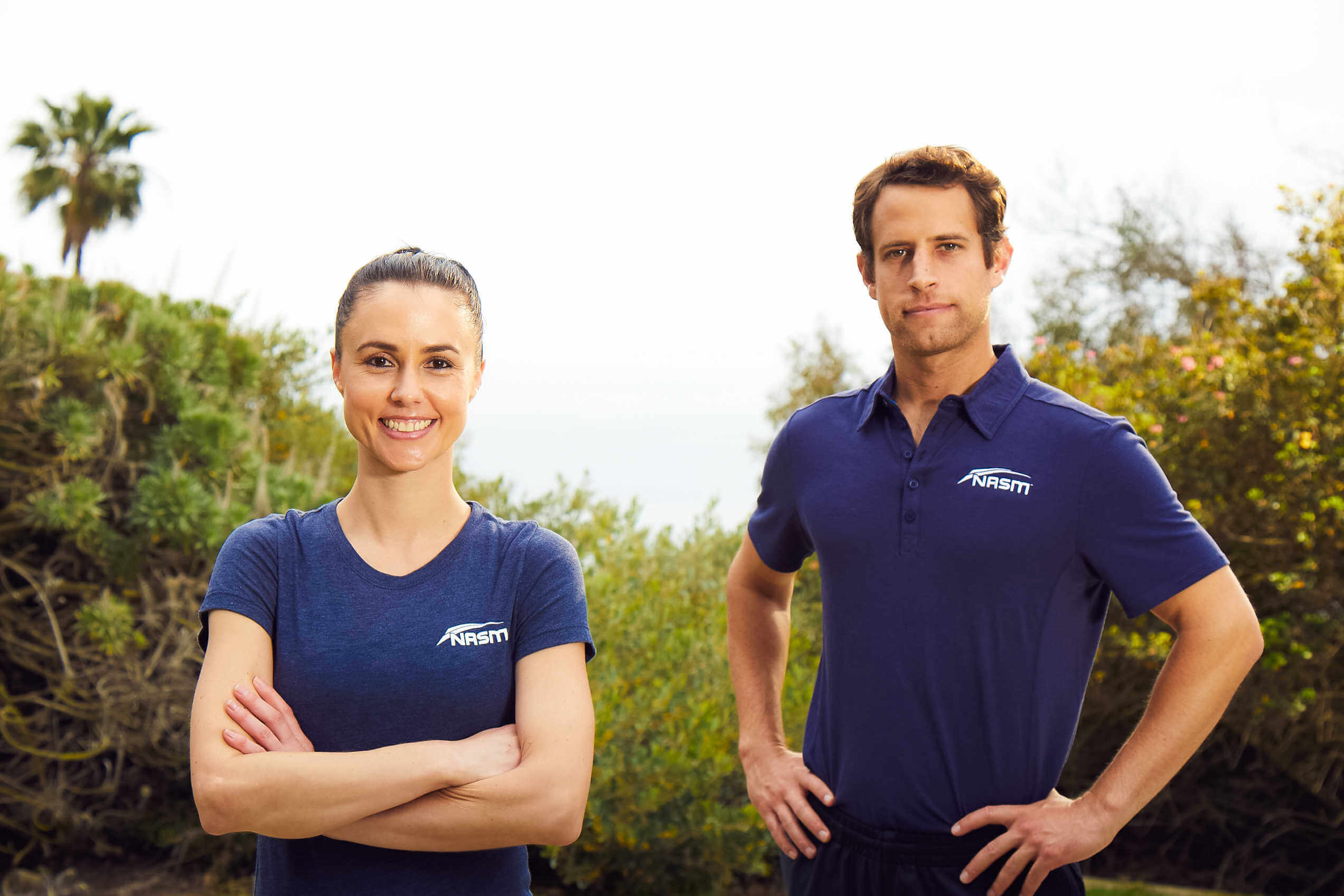 Two personal trainers standing