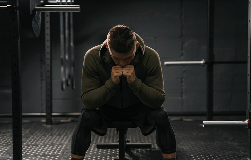 A man stressed at a gym