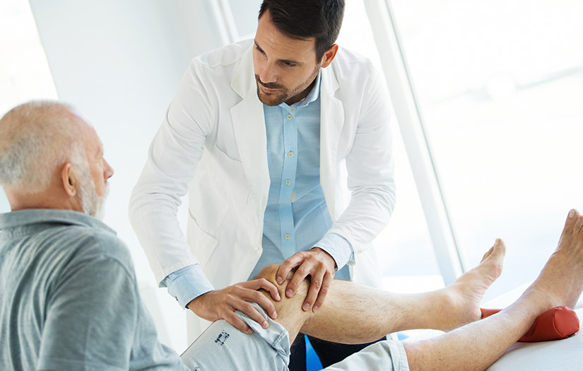 man treating a client with arthritis