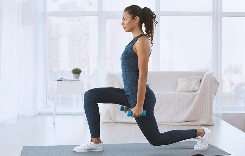woman doing a lunge at home