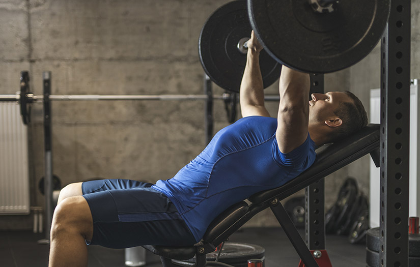 man bench pressing with elbow pain