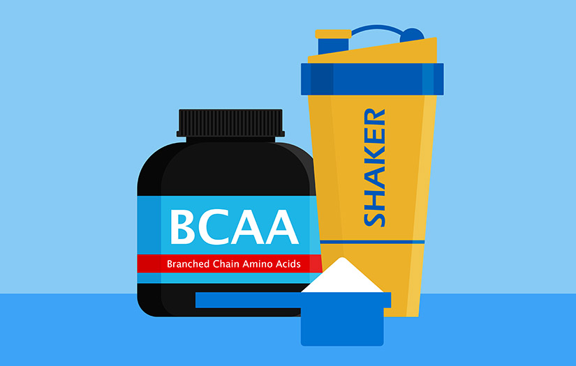 a container of BCAAs, a shaker, and a scoop