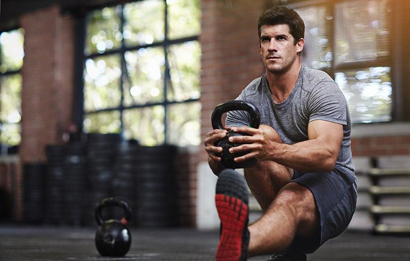 a man doing a functional training kettlebell squat