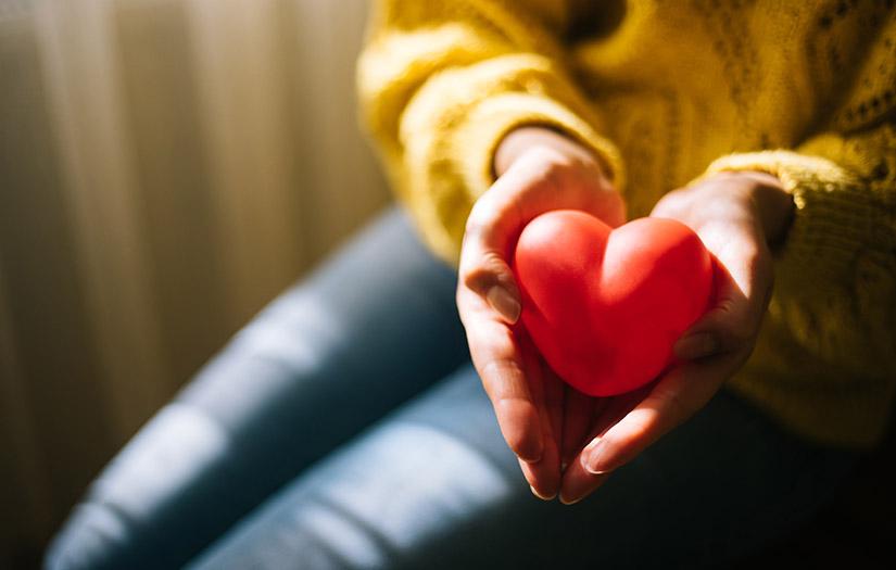 woman holding a foam heart