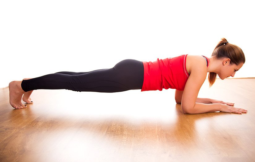 woman performing a standard plank