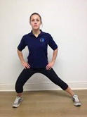 woman doing a standing inner though stretch