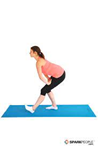 woman doing a standing hamstring stretch