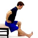 man doing a sitting hamstring stretch