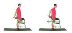 man doing a standing quad stretch