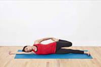 woman doing a laying down quad stretch