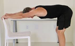 man doing a standing lat stretch