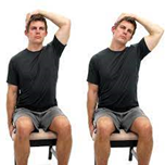 man doing a sitting trap stretch