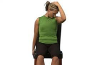 woman doing a sitting levator scapulae stretch