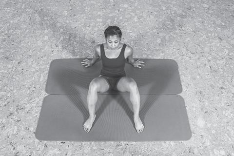 woman doing a hip spine shoulder stretch