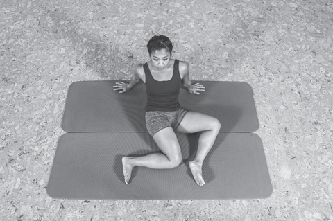 figure 2 of woman doing a hip spine shoulder stretch