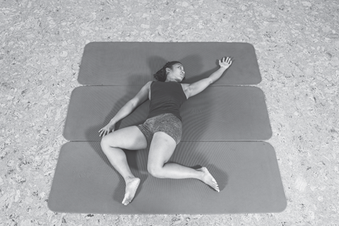 woman stretching shoulders and hips
